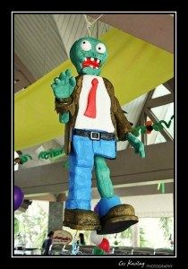 This amazing Plants Vs Zombies zombie party pinata was featured on Sweet Boutique's party ideas blog.  It looks so realistic and true to character.