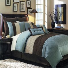 The Blue & Chocolate Hudson 12-piece comforter set by Royal Tradition offers a modern, tailored look that creates an aura of calmness in any bedroom.  Nature-inspired colors in shades of Blue, Brown and Off White  Bold color blocking for strong design impact  All the pieces you need for a flawlessly decorated bed  100% Polyester Machine Washable