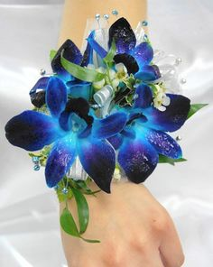 (Thingy for the moms) A spray of dendrobium orchids nestles against shiny green leaves in this traditional design. Blue Corsage, Prom Corsage And Boutonniere, Flower Corsage, Corsage Wedding, Bridesmaid Bouquet, Wedding Bouquets, Wrist Corsage, Boutonnieres, Dendrobium Orchids