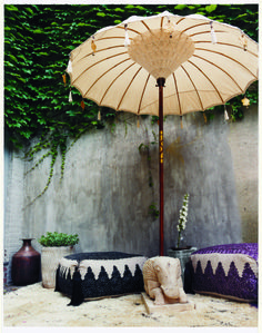 See more images on domino.com Outdoor Moroccan lounge area umbrella