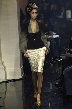 Jean Paul Gaultier SS 2006 inspired by Minoan tight bodice that goes under the breasts.