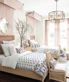 Prettiest girls room in blush and rattan.