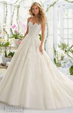 Wedding dress idea; Featured: Mori Lee Planning a destination wedding? Get tips and advice or plan online by yourself!! More info at www.destinationweddingcollective.com