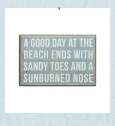 """Good day at the beach sign. """"A good day at the beach ends with sandy toes and a sunburned nose"""". Weathered and rubbed wood creates beach wall art that looks aged from wind, sand and sun."""