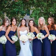 Love the wedding dress, the bridesmaid dresses, and color scheme/flowers