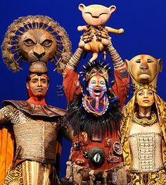 Nathaniel Stampley as Mufasa, Tshidi Mayne as Rafiki and Jean Michelle Greier as Sarabi in The Lion King.