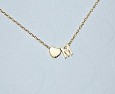 Tiny initial necklace - little gold initials on gold filled chain - double - simple modern jewelry - Bea. $31.00, via Etsy.