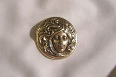 Art Nouveau style repousse woman's face Brooch