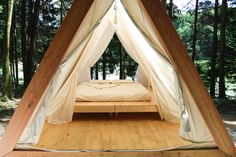 Lushna designs and builds these modern, tent-like shelters to put on your property to house guests, start a campground, or a glamping hotel.