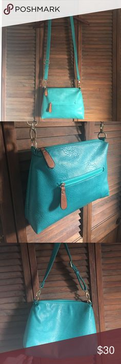 Turquoise Genuine Leather Crossbody EUC 🚫no trades 🚫 no brand. (Free people to be seen) Genuine Italian Leather turquoise adjustable Crossbody. I would carry a long wallet, 2 planners, my iPhone 6plus, a large water bottle, chapsticks in this. Can fit more than you'd think! Even a smaller tablet of a kindle. Super soft leather! No cracks, scuffs, pen marks or stains. Does not feel cheap one bit. Genuine Leather. Perfect condition. About the size of a sheet of paper. ----- 8.5 H x 11 W x 2…