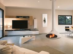 The floating Ergofocus is available in this stunning white finish. All Focus fireplaces are hand made by metal artisans in the South of France. These fireplaces are truly a work of art as well as a fireplace! Suspended Fireplace, Hanging Fireplace, Open Fireplace, Fireplace Design, Home Design, Interior Design, Design Ideas, Focus Fireplaces, Modern Fireplaces