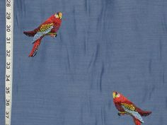 This novelty home decorating fabric is unique for it's embroidered parrot.    The base cloth was a synthetic, slubbed, to look like a silk. the color saturaton was excellent, and the embroidered bird stood out well from the background.     Promotional novelties for your business or organization
