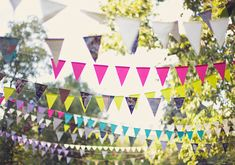 colorful bunting   photo by Brooke Courtney   100 Layer Cake