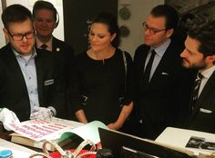 """Crown Princess Victoria, Prince Daniel and Prince Carl Philip of Sweden visited the Center for Business History in Stockholm on December 17, 2015. Crown Princess Victoria wore a new Seraphine Black Zip Detail Maternity Dress. The Zip Detail Maternity Dress retails for £85.00 on the """"SERAPHINE"""" website."""