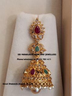 Traditional designs made with perfect finish. Beautiful jumkhi studded with uncut diamonds and pearl hangigns. Visit for full variety at best prices. Contact no 8125 782 01 May 2018 Gold Jhumka Earrings, Jewelry Design Earrings, Gold Earrings Designs, Gold Jewellery Design, Ear Jewelry, Fancy Jewellery, Gold Designs, Ruby Jewelry, Gold Jewelry Simple