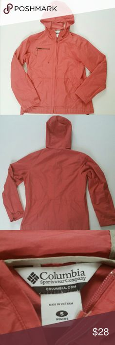 Lightweight Columbia Hooded Spring Jacket This Columbia Jacket is a light Coral Pink. It zips up the front and has unzippered kangaroo style front pockets. There is a top pocket with a zipper. It has an adjustable drawstring on the inside bottom. It is in great used condition, no stains or rips. The fabric is a  cotton and nylon blend. Columbia Jackets & Coats