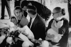 Killed: Marina Oswald (left) at the funeral of her husband Lee in 1963 who was shot by Jack Ruby. She is holding her 22-month-old daughter niece June alongside Lee's brother Robert (centre) and mother Marguerite (right)  Check out all the latest News, Sport & Celeb gossip at Mirror.co.uk http://www.mirror.co.uk/news/world-news/john-f-kennedy-lay-dying-2670122#ixzz2kN82SQcR  Follow us: @DailyMirror on Twitter   DailyMirror on Facebook
