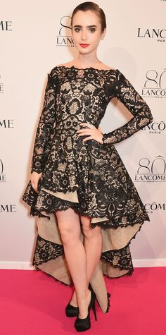 Lily Collins flirted with flair for the Lancome 80th Anniversary Party in a off-shoulder black lace Mikael D high-low number, accessorizing with Messika diamonds and black satin Giuseppe Zanotti platform pumps.