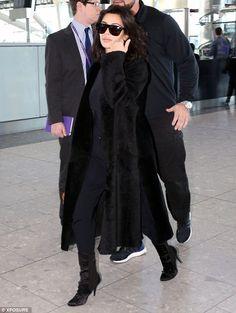 Laters: Kim Kardashian said goodbye to London on Friday morning as she arrived at Heathrow...
