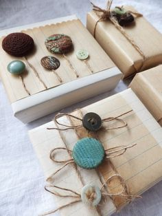Vintage wrapping with old notebook paper and buttons!