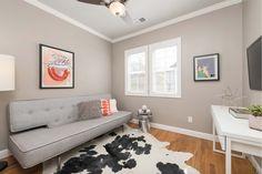 Eclectic Living Room with flush light, Ceiling fan, Hardwood floors, Crown molding, High ceiling, Carpet
