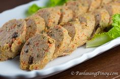 Pork Embutido is a type of Filipino meatloaf. It is composed of ground pork, vegetables, cheese, raisins, and seasonings. Pork Recipes, Gourmet Recipes, Cooking Recipes, Healthy Recipes, Filipino Dishes, Filipino Recipes, Filipino Food, Pork Embutido Recipe, Eggplant Pizzas