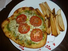 Naan pesto pizza - pesto made from Food Network magazine recipe.  French fries from Food Network mag.