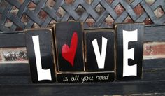 Home decor or Valentines wood blocks---Love is all you need. $14.00, via Etsy.