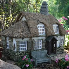 """Mustard Seed Cottage  There won't be any homeless fairies with this charming cottage in your garden.  The cottage is made of durable polystone in 1:12 scale,  with stone foundation, mullioned windows  and thatched roof.   22"""" W x 16"""" D x 17"""" H.    Price: $299.99"""