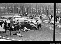 Students dive to the ground as the Ohio National Guard fires on faculty and students on May 4, 1970. (Kent State University
