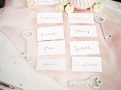 gold calligraphy wedding reception escort cards