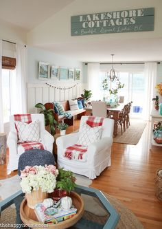 Love the wainscoting and colors. beautiful-light-bright-and-airy-fall-home-tour-lakehouse-home-tour-with-pops-of-coral-and-fall-plaids-at-the-happy-housie-30