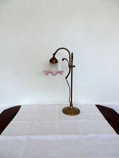 Antique French bronze table lamp with pink tulip shade