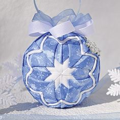 This unique quilted ornament looks hand sewn, but it's not! No sewing required. Simply fold fabric and pin in place with easy to follow instructions.