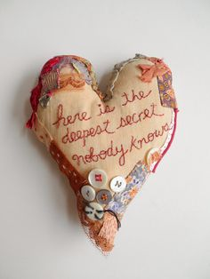 embroidered heart, line from e.e cummings poem, One Bunting Away