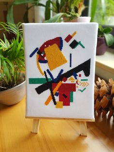 My first cross stitched pattern was inpired by a Wassily Kandinsky abstract piece. I like his work because if has vivid colors and he uses a lot of geometric forms which is quite easy to transform into a cross stitch pattern. Cross Stitch Geometric, Modern Cross Stitch, Cross Stitch Patterns, Cross Stitches, Abstract Painters, Abstract Art, Abstract Embroidery, Modern Art, Art Pieces