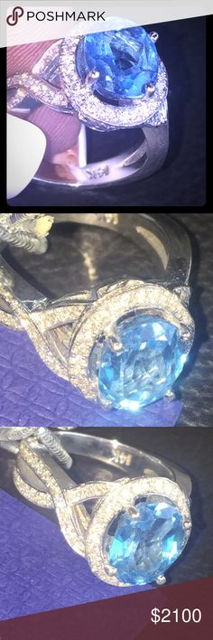 14K Blue topaz vS quality Diamond Ring Custom made with Over 100counts of VS diamonds all around the brilliant blue Crystal topaz Retails at 4500$With the engraved enchanting design makes this ring a must have!! My picture do no justice!! This can be a engagement ring a wedding ring a big I LOVE YOU RING!! Heart melting🎁💎💎💎💎💎💎 upon request a certificate of certified gold and diamonds will be available upon purchase Jewelry Rings