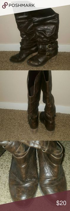 Dark brown boots Dark brown boots with a 3 inch heel that are gently worn. There are a few minor spots as can be seen in picture 3. These look great with jeans or dresses and are very comfortable. Shoes Heeled Boots