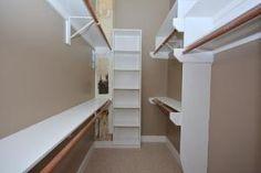 narrow walk-in closet by jane