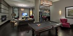 Halstead Square's residential lounge includes a commercial demonstration kitchen, lounge area, billiards table, artisan fireplace, and more