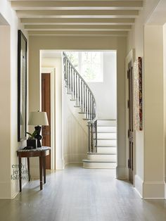 Foyer/Hallway  ||  Inside the house, the light wood floors and open and connected feel of the floorplan work seamlessly with the French Normandy style of the exterior.