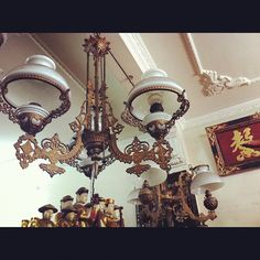 really into these antique light fixtures in saigon most likely from french colonial period but can't seem to find any more info