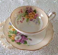 Peach and white teacup with floral bouquet pattern