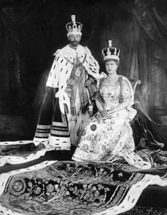 The 1911 Coronation. King George Vand Queen Mary are wearing their purple coronation robes.Both sets of purple robes are only worn once, the crimson Parliamentary robes being worn on other occasions. Queen Mary chose to repeat Queen Alexandra's new formula robe which, unlike the old queen consort's robe, was a positive riot of bullion embroidery.