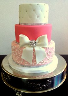 Quinceneara pink and bling cake with bow.  All marshmallow fondant.  Our fondant now available at: https://www.etsy.com/listing/208545746/homemade-marshmallow-fondant-2-pounds?