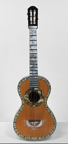 Guitar Place of origin: Barcelona (city), Spain (made) Date: 1840-1849 (made) Artist/Maker: Altimira (maker) Materials and Techniques: Pine back and sides, veneered with amboyna; engraved and painted ivory plaque on the back; pine soundboard, with mother-of-pearl openwork; painted mother-of-pearl purfling (bordering); ebony-veneered neck Credit Line: Given by Manuel Terrero