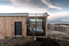 Panorama Glass Lodge makes a log cabin stay in Iceland even more memorable. Here, guests can sleep under the stars and admire the Northern Lights through the glass ceiling and walls. Glass Ceiling, Glass Roof, Tiny House Cabin, Cabin Homes, Cabana, Places Around The World, Around The Worlds, Tiny House France, Glass Cabin