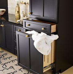 "Built-in Laundry Hamper | ""Venetian"" Bathroom Cabinetry in Black, by Plain & Fancy Custom Cabinetry | keywords: closet, wardrobe, dressing room"