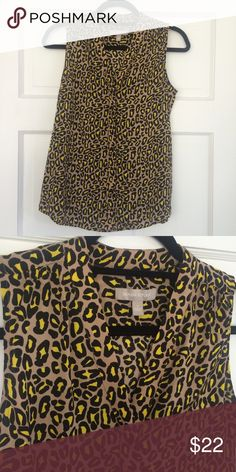 Banana Republic leopard blouse Sz 2 Tan, black and yellow leopard print sleeveless blouse from Banana Republic. In excellent condition. V neck with hidden front button closures. Perfect for fall with a cardi or blazer. 100% polyester - machine washable. All reasonable offers considered. Banana Republic Tops Blouses