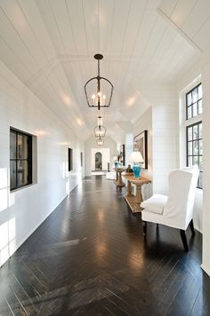 Horizontal tongue and groove with high ceilings, lanterns, & walnut herringbone floors
